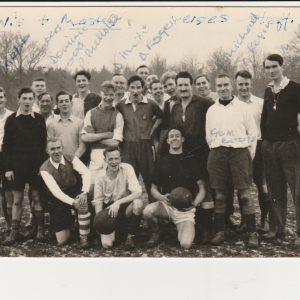"OW plus Masters v Staff. 1957 (Masters won3-1!)     L – R Standing: Dom Fabian, Webb, Chambers, Dom Dominic,  u/i, Wood, Mellotte, Folded arms u/i, Dom Hugh, u/i, Dom Roger, Several u/i, Dom Michael, Dom Kevin, Mr Keane (Referee)                                        Kneeling in front: u/i, u/i, ""Gumboots""."