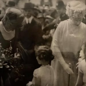 Suzanne and Marie Agius , granddaughters of Edward Tancred Agius) presenting bouquets to Queen Elena and Queen Mary