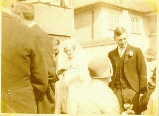 The man looking down is Atfield Brooks, Fritz's cousin and best man. Marie is talking to her brother Ken (Donalds twin)